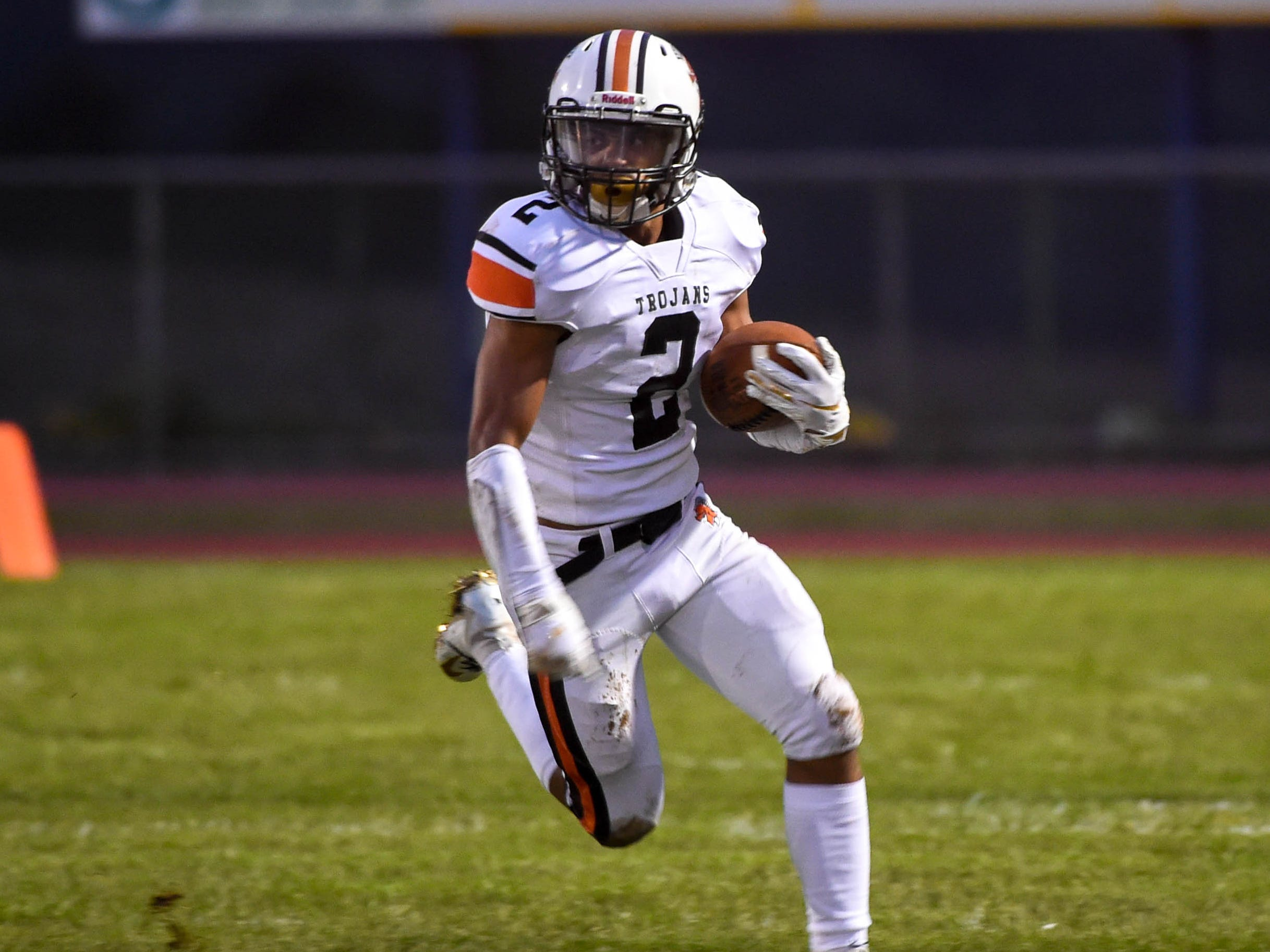 York Suburban's Savion Harrison (2) runs the ball past the defense during their game against Kennard-Dale, Friday September 21, 2018. The York Suburban Trojans beat the Kennard-Dale Rams 31-25.