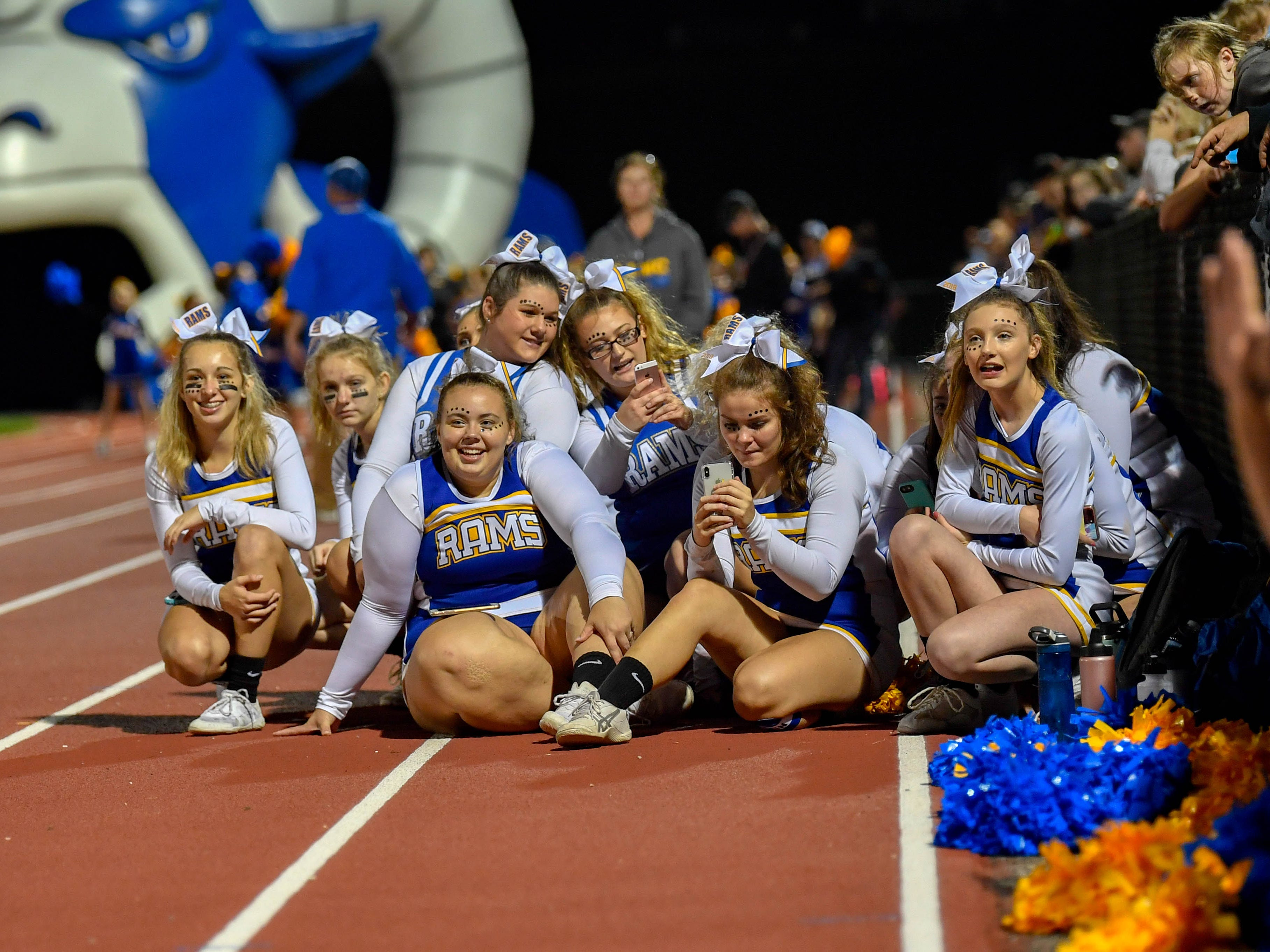 Kennard-Dale cheerleaders watch as youth cheerleaders perform their routine, Friday, September 21, 2018. The York Suburban Trojans beat the Kennard-Dale Rams 31-25.
