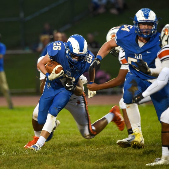 Josh Vipperman (26) fights past the line of scrimmage, Friday, September 21, 2018. The York Suburban Trojans beat the Kennard-Dale Rams 31-25.