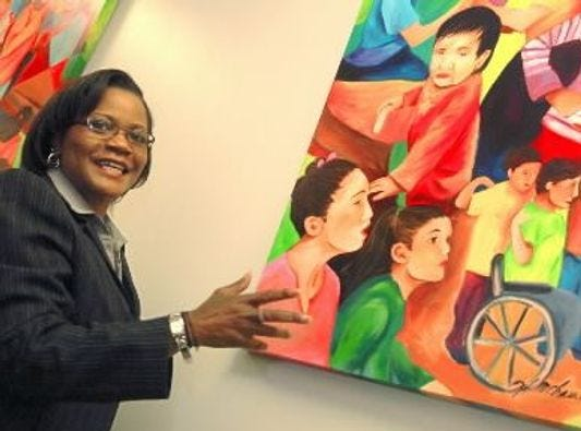 Ophelia Chambliss is pictured with her work that was unveiled as part of the York Day Nursery's 75th anniversary several years ago. The organization is one of several in York County founded in the Great Depression.