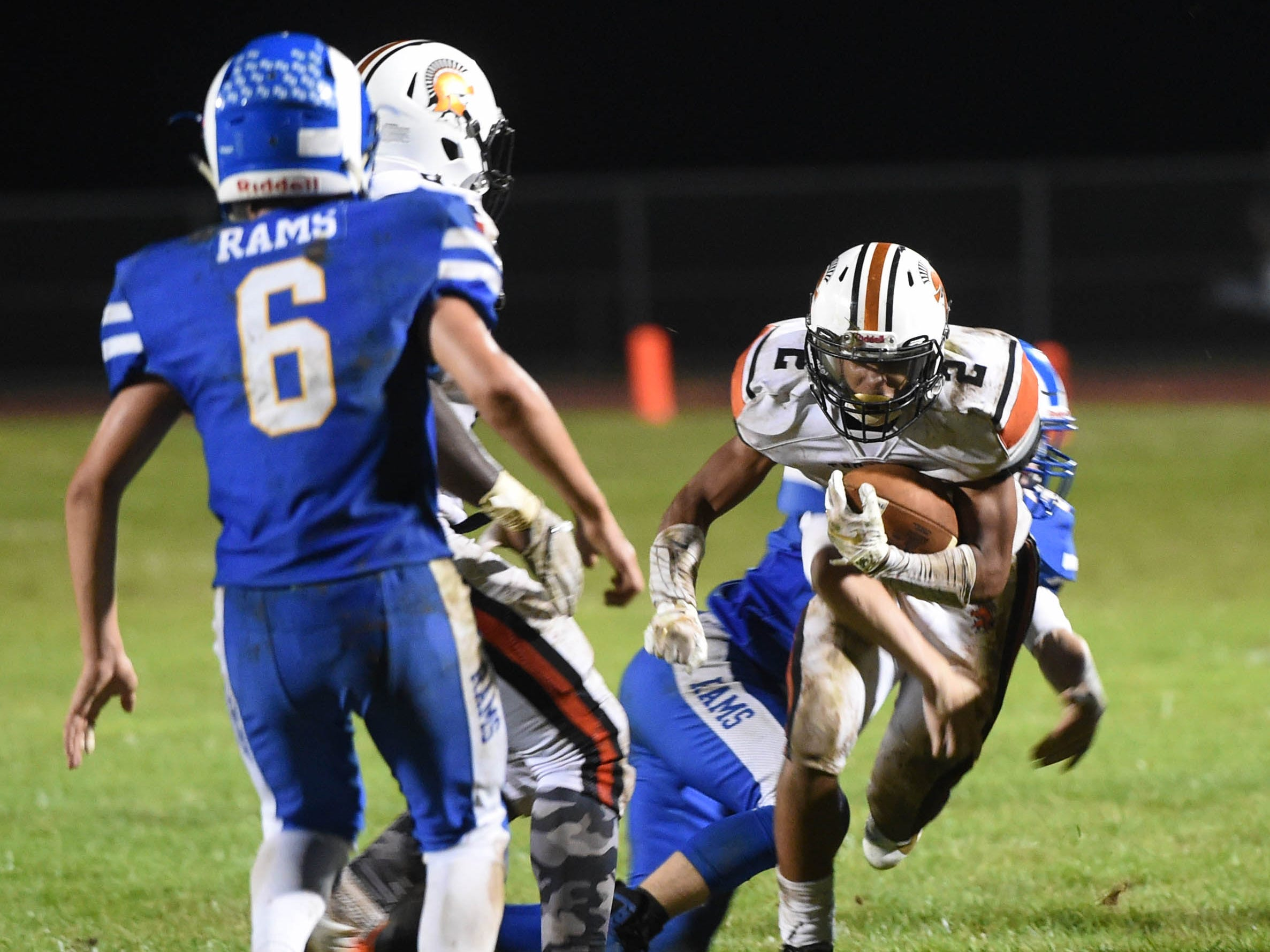 Savion Harrison (2) gets brought down during the Division II football game between Kennard-Dale and York Suburban, Friday, September 21, 2018. The York Suburban Trojans beat the Kennard-Dale Rams 31-25.