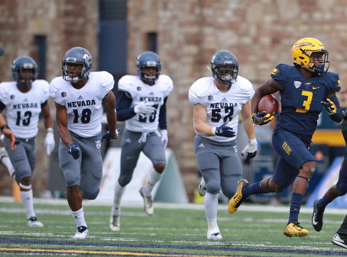 Toledo's Diontae Johnson returns a kickoff 98 yards for a touchdown Saturday against Nevada.