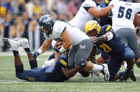Nevada's Toa Taua rushes against Toledo on Saturday.
