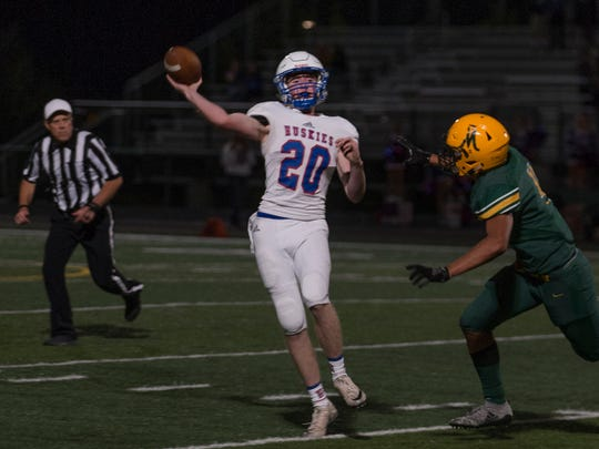 Reno's Ryan Forderhase throws against Manogue on Friday night