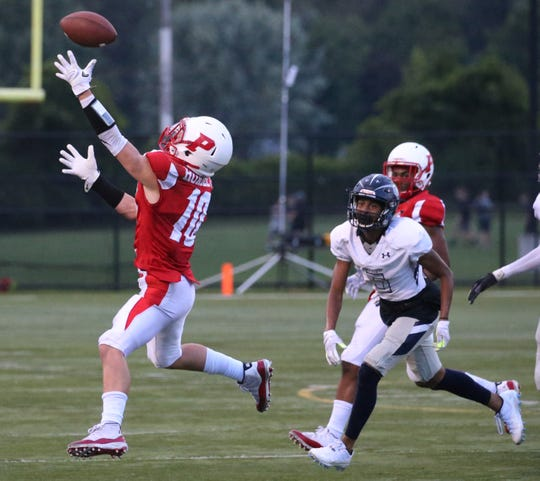 Penfield's Max Hoadley makes a nice one handed reception for a big gain in the first half during their game at Penfield High Friday, Sept 21, 2018.