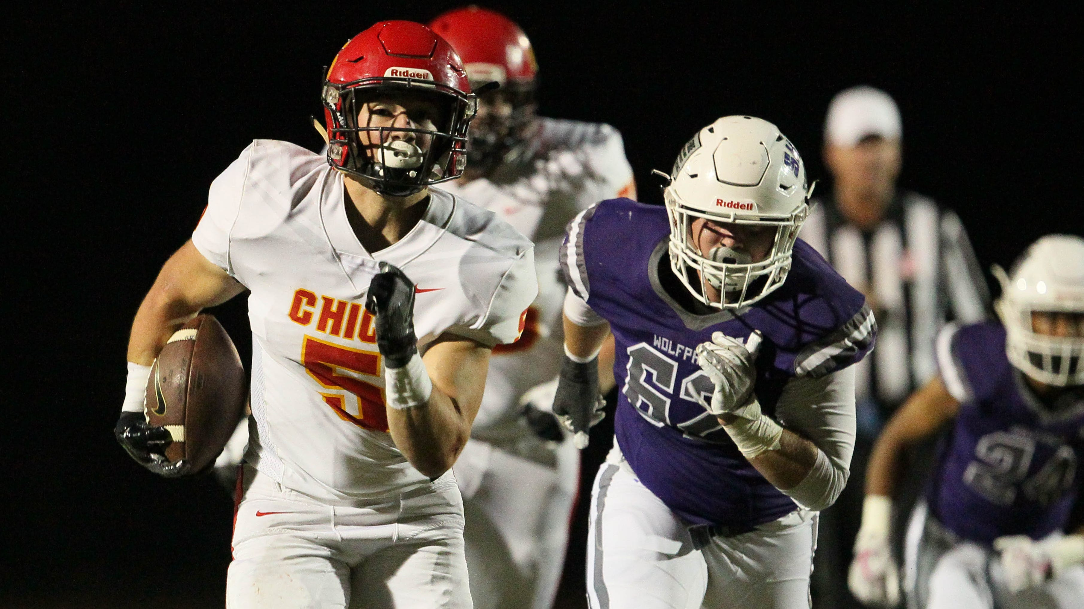 Chico's Ty Walker (5) heads toward the end zone to score a touchdown in the 1st quarter against Shasta's Logan Thibodeau (62). Chico won the game, 37-0, at Shasta High on Friday, Sept. 21.