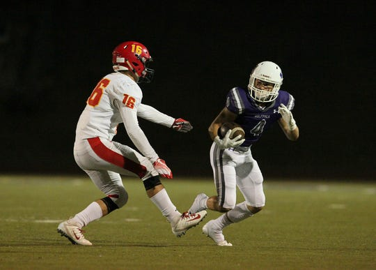Shasta's Brayden Coon (4) tries to break away from Chico's Kobe Hood (16) in the 1st quarter.  Chico won the game, 37-0, at Shasta High on Friday, Sept. 21.