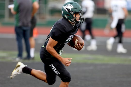 West Salem's Anthony Gould (23) warms up before the start of the Sheldon vs. West Salem football game at West Salem High School on Friday, Sep. 21, 2018.
