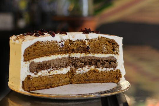 Autumn Cake at Sweetsmith. Two layers of burternut squash and pumpkin spice cake with a layer of gingerbread cookie in between.