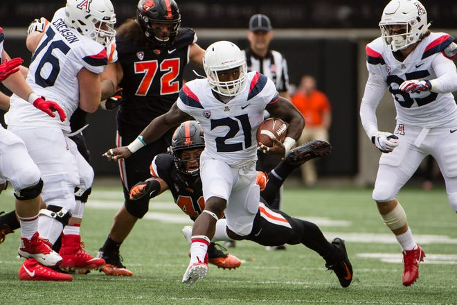 Sep 22, 2018; Corvallis, OR, USA; Arizona Wildcats running back J.J. Taylor (21) breaks a tackle on his way to a touchdown during the first half against the Oregon State Beavers at Reser Stadium. Mandatory Credit: Troy Wayrynen-USA TODAY Sports