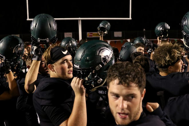 West Salem huddles together following the Sheldon vs. West Salem football game at West Salem High School on Friday, Sep. 21, 2018. Sheldon won the game 56-21.