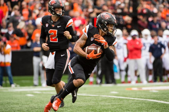 Sep 22, 2018; Corvallis, OR, USA; Oregon State Beavers wide receiver Trevon Bradford (8) takes the ball up the field for a first down during the first half against the Arizona Wildcats at Reser Stadium. Mandatory Credit: Troy Wayrynen-USA TODAY Sports
