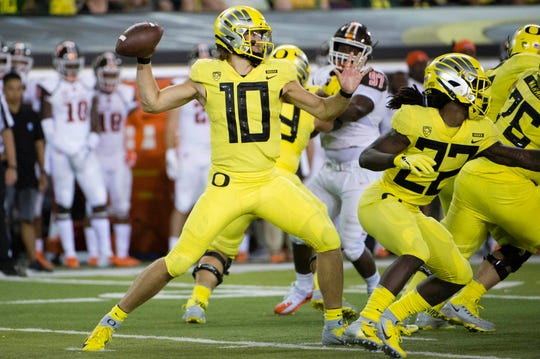 Sep 1, 2018; Eugene, OR, USA; Oregon Ducks quarterback Justin Herbert (10) throws a pass during the second half against the Bowling Green Falcons at Autzen Stadium. The Ducks won 58-24. Mandatory Credit: Troy Wayrynen-USA TODAY Sports