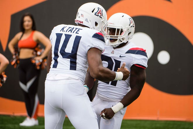 Sep 22, 2018; Corvallis, OR, USA; Arizona Wildcats running back J.J. Taylor (21) celebrates with quarterback Khalil Tate (14) during the first half after scoring a touchdown against the Oregon State Beavers at Reser Stadium. Mandatory Credit: Troy Wayrynen-USA TODAY Sports