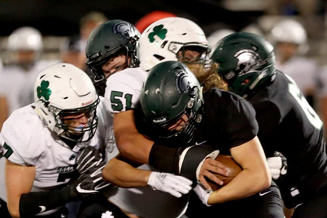 West Salem's Jordan Whitaker (42) slams through the Sheldon defense in the first half of the Sheldon vs. West Salem football game at West Salem High School on Friday, Sep. 21, 2018.
