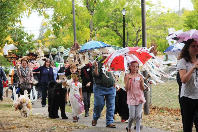People make their way to Winter Street with their puppets at the 2nd Annual Salem Puppet Parade on Saturday, Sept. 22. More than 75 people participated in the event.