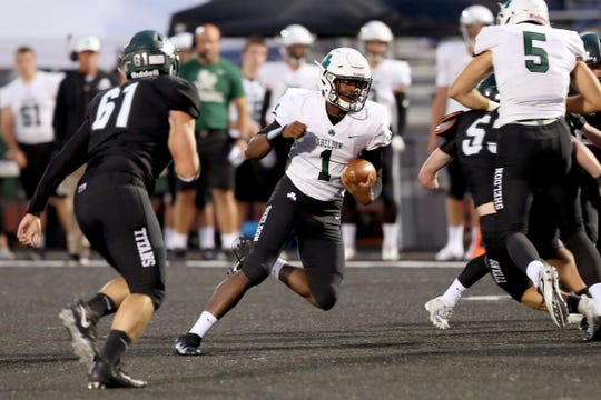 Sheldon's Michael Johnson Jr. (1) rushes in the first half of the Sheldon vs. West Salem football game at West Salem High School on Friday, Sep. 21, 2018.