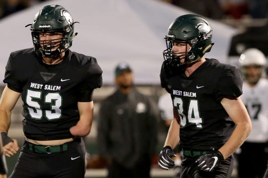 West Salem's Alex Hurlburt (53) and Kaiden Reidhead (34) in the first half of the Sheldon vs. West Salem football game at West Salem High School on Friday, Sep. 21, 2018.