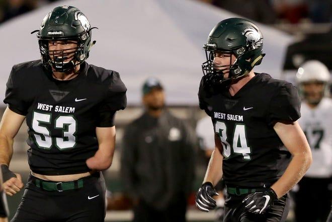 West Salem's Alex Hurlburt (53) and Kaiden Reidhead (34) in the first half of the Sheldon vs. West Salem football game at West Salem High School on Friday, Sep. 21, 2018.