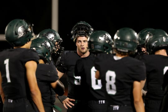 West Salem's Alex Hurlburt (53) and others take a timeout in the first half of the Sheldon vs. West Salem football game at West Salem High School on Friday, Sep. 21, 2018.