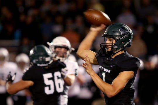West Salem's Simon Thompson (1) passes the ball in the first half of the Sheldon vs. West Salem football game at West Salem High School on Friday, Sep. 21, 2018.