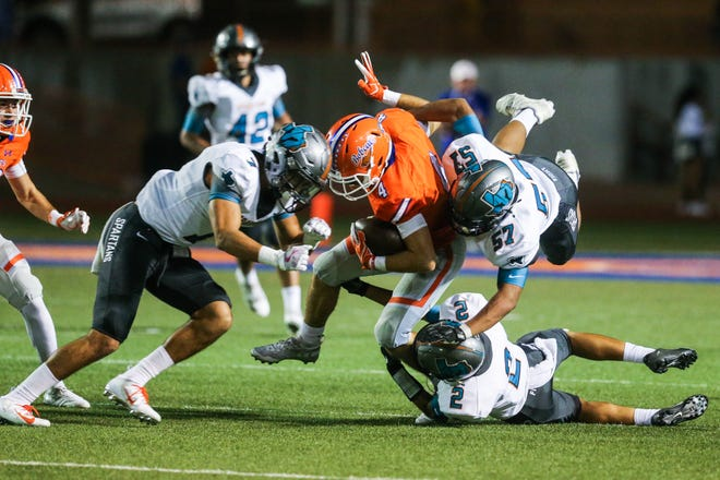 Central's Jackson Timme is tackled by Pebble Hills defenders Friday, Sept. 21, 2018, at San Angelo Stadium.