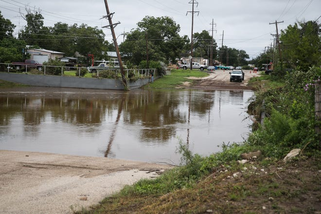 A street crossing a draw is flood Saturday, Sept. 22, 2018, in Sonora.