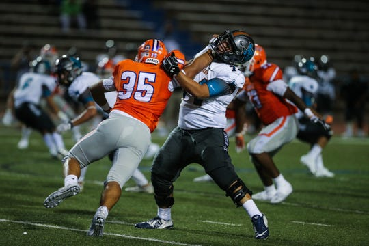 Central's Anthony Gonzales tries to get past an El Paso Pebble Hills blocker Friday, Sept. 21, 2018, at San Angelo Stadium.