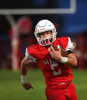 Miles' Mason Bryan makes a play down field at Friday nights game against Baird in Miles, Sept. 21, 2018