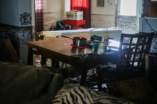 A refrigerator lays on its side and a table shifted in Sonia Reyes' home Saturday, Sept. 22, 2018, after rain water flooded the home Friday afternoon in Sonora.