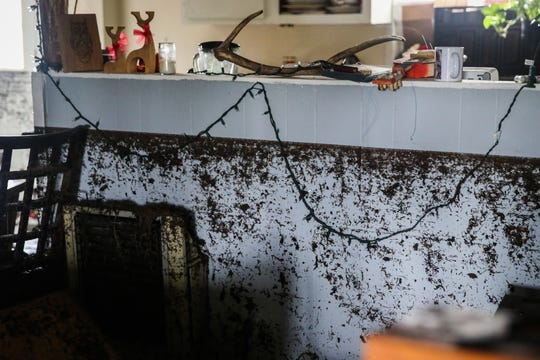A line of mud is left across Sonia Reyes' walls Saturday, Sept. 22, 2018, after rain water flooded the home Friday afternoon in Sonora.