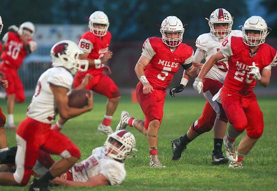 Miles' Mason Bryan (#5) and Sterling Barker (#20) keep their eyes on a Baird player at Friday nights game in Miles, Sept. 21, 2018