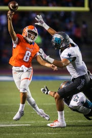 Central's Malachi Brown passes the ball as Pebble Hills defends Friday, Sept. 21, 2018, at San Angelo Stadium.