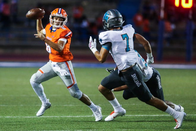 Central's Malachi Brown looks to pass the ball as Pebble Hills approaches Friday, Sept. 21, 2018, at San Angelo Stadium.