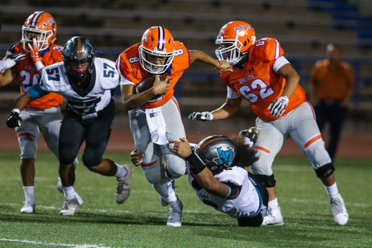 Central's Malachi Brown runs the ball as Pebble Hills tries to block Friday, Sept. 21, 2018, at San Angelo Stadium.
