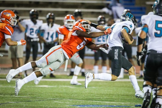 Central's Daylon Green jumps to tackle an El Paso Pebble Hills ball carrier in a 2018 game.