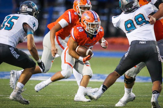 Central's Bobby Pena runs the ball around Pebble Hills defense Friday, Sept. 21, 2018, at San Angelo Stadium.