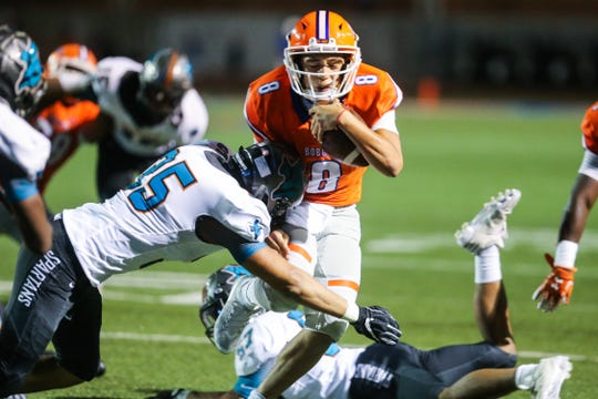 Central's Malachi Brown is tackled by an El Paso Pebble Hills defender Friday, Sept. 21, 2018, at San Angelo Stadium.