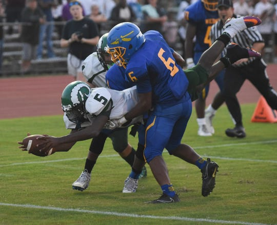 Parkside's Marcus Yarns dives over the goal line to score the teams first touchdown during first half action at the Parkside/Wicomico High School Football game Friday, Sept. 21, 2018 at County Stadium. (Photo by Todd Dudek for The Daily Times)