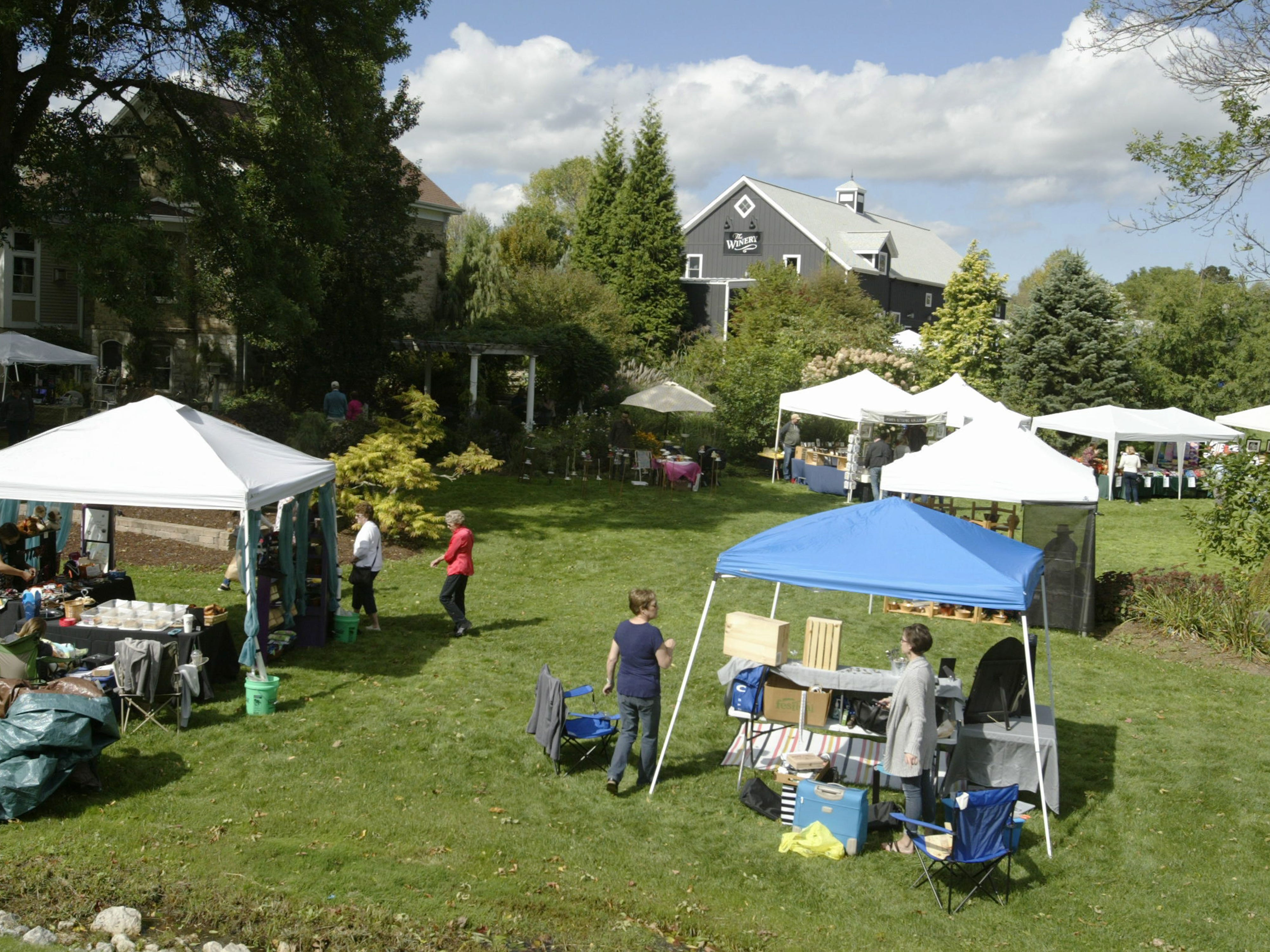 Vendors dot the yard during the Harvest Festival & Grape Stomp at The Blind Horse Restaurant and Winery, Saturday, September 22, 2018, in Kohler, Wis.