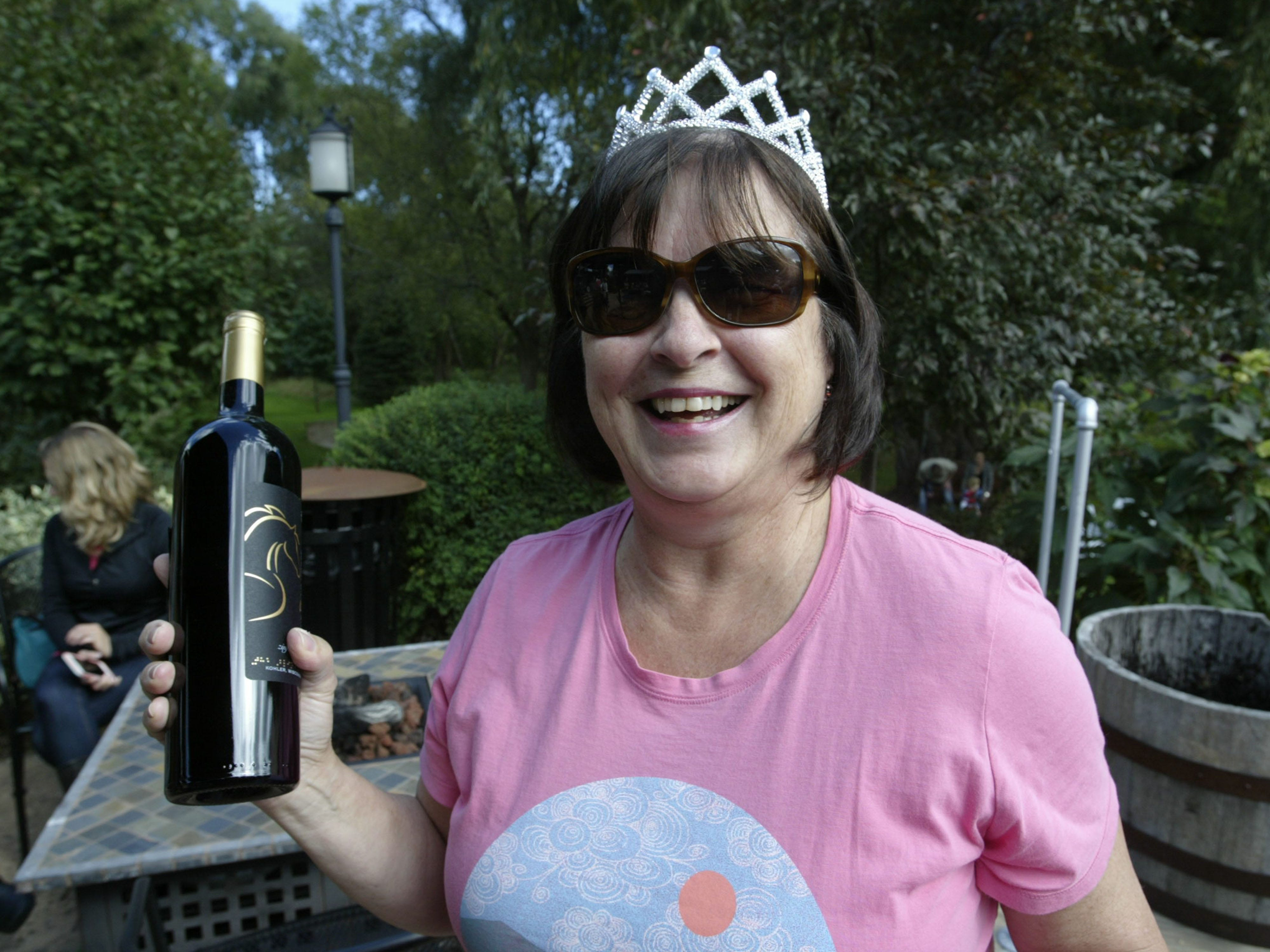 Nancy Neusen of Fond du Lac, Wis. smiles following her win in the grape stomp at the Harvest Festival & Grape Stomp at The Blind Horse Restaurant and Winery, Saturday, September 22, 2018, in Kohler, Wis. Winners got a bottle of The Blind Horse Winery wine.