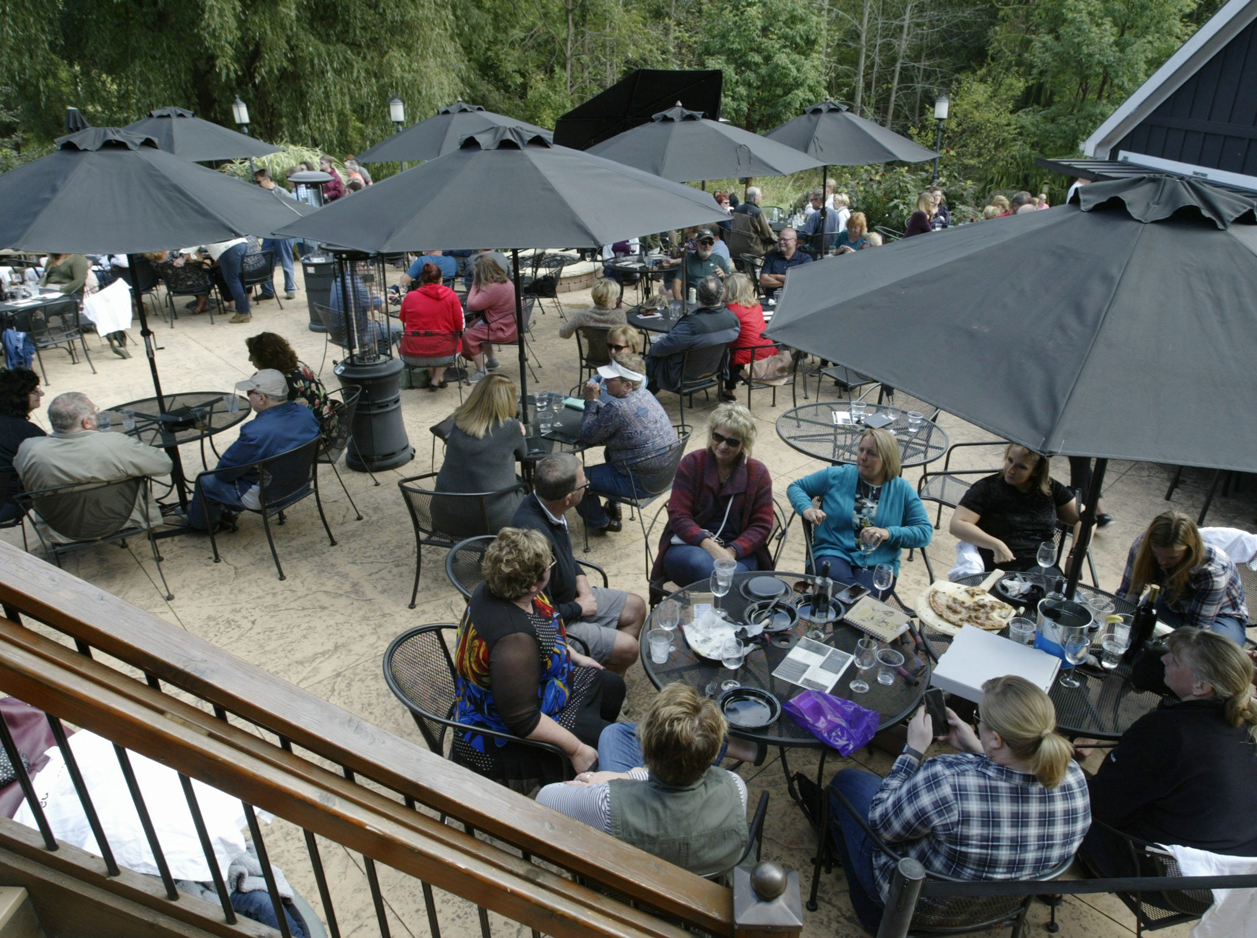 An overall of people enjoying themselves at the Harvest Festival & Grape Stomp at The Blind Horse Restaurant and Winery, Saturday, September 22, 2018, in Kohler, Wis.
