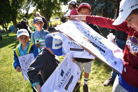 Young golfers wait to get autographs during the Sanford International tournament Saturday, Sept. 22, at the at Minnehaha Country Club.