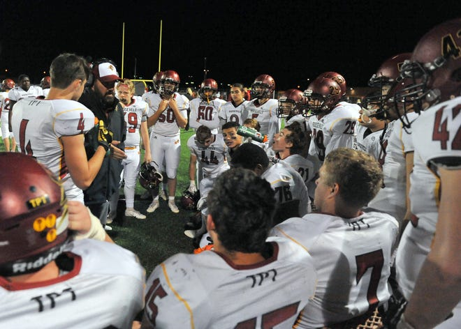 Roosevelt players gather on the sideline against Brandon Valley on Friday, Sept. 21, in Brandon.