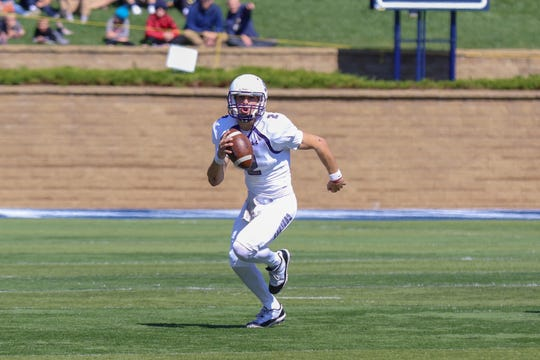 USF's QB #2 Caden Walters escapes the pocket looking for a reciever during the first half of their Key To The City game against Augustana.