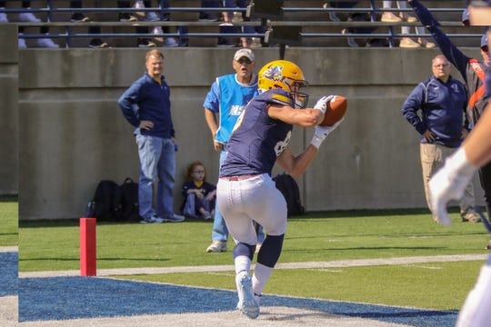 Augustana's WR #86 Brett Shepley catches a touchdown pass from QB #11 Kyle Saddler during the first half of the Key To The City game.
