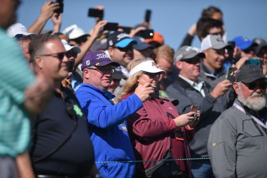 People pull out their phones while Andy North, Jack Nicklaus, Dave Stockton and Graham Marsh prepare to tee off in the Sanford International tournament Saturday, Sept. 22, at the at Minnehaha Country Club.