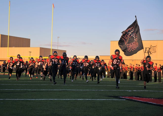The Brandon Valley football team takes the field before a game against Sioux Falls Roosevelt in 2018.