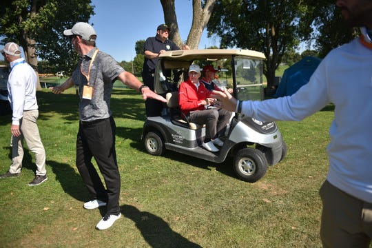 Andy North and his caddy cut through the course to get to the next hole during the Sanford International tournament Saturday, Sept. 22, at the at Minnehaha Country Club.