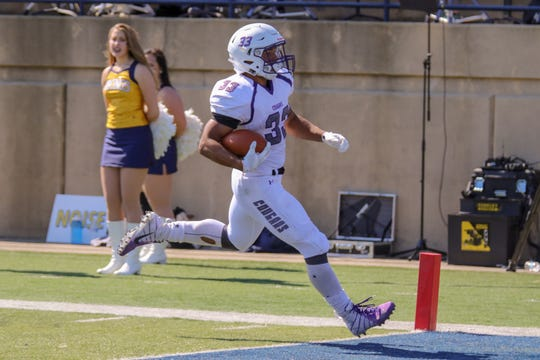 USF's #33 Gabe Watson scores a TD during the first half of the Key To The City game against Augustana.